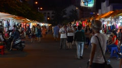 Shopping people in night market in Saigon city Stock Footage