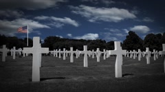 Military Cemetery with Timelapse Clouds and Waving Flag in the Background - stock footage