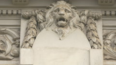 Bas-relief representing a lion head on a building in Bucharest Stock Footage