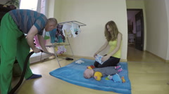 Family and child at home routine: floor cleaning laundry folding. 4K Stock Footage