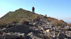 Excursionist who climbs on an upward path on mountainside 22c Stock Footage