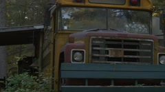 walking towards abandoned school bus in woods to lens flare- creepy - stock footage