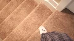 Gimbal shot of man walking down stairs Stock Footage