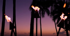 Fire torches in Waikiki beach sunset evening Stock Footage