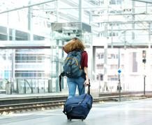 Young woman walking with luggage Stock Photos