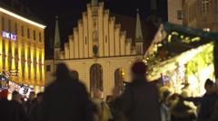 People walking on the background of Christmas Bazaar Catholic Church Stock Footage