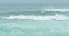 Professional surfer surfing in Hawaii north shore sunset beach - stock footage