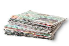Stack of Daily Newspapers isolated on white background - stock photo