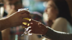Attractive man is drinking lager beer that was given to him by bartender - stock footage