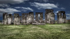Stonehenge ruins with clouds in the background in time lapse, - stock footage