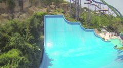 Fun with girl on water slide in aqua park - stock footage