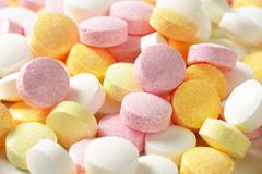 Lentil-shaped fruit flavor candy in soft pastel colors - stock photo