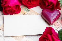 Vintage background with hearts and roses Stock Photos