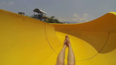 Fun on the water slide in aqua park Stock Footage