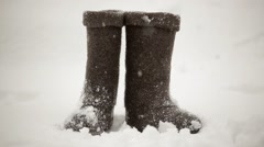 Felt boots in the snow Stock Footage