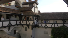 Walking along the balconies in the inner courtyard of Bran Castle Stock Footage