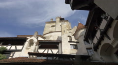 Tilt down view of Bran Castle's interior courtyard Stock Footage