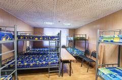 bunk metal beds in hostel room - stock photo