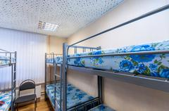 Stock Photo of bunk metal beds in hostel room