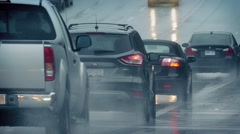 Many Cars Passing On Road In The Rain Stock Footage
