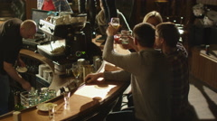 Two girls are dancing with drinks on a table in a bar Stock Footage