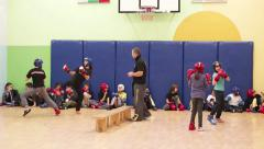 Children sparring in training in karate. Teaching children protection Stock Footage