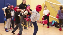 Children learn martial arts in training to fight. Practiced punches Stock Footage