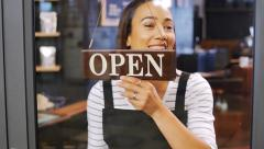 Happy worker opening shop Stock Footage