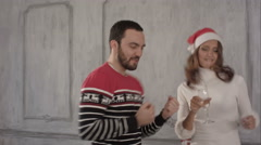 Happy couple dancing at Christmas celebration near New Year's tree - stock footage