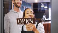 Small business owners opening shop Stock Footage