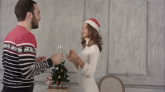Friends talk and dance during christmas party - stock footage