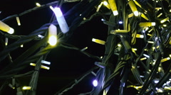 Yellow and blue light from a garland lamp Stock Footage