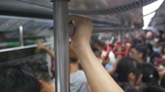 Hand holds rails on subway train - stock footage