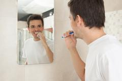 Man washing his teeth - stock photo