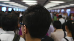 Crowds on subway in Hong Kong Stock Footage