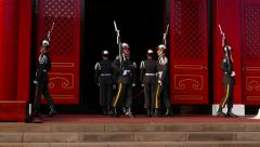 Officers turn, flip rifle, salute during ceremonial guard change ceremony Stock Footage