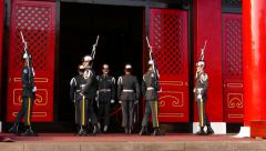 Sentinel salute during change ceremony, against Main Shrine entrance Stock Footage