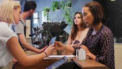 Mobile payment in busy coffee shop Stock Footage