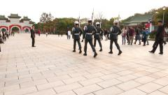 POV follow honour guard soldiers march to gate, during ceremonial change Stock Footage