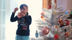 Children decorating Christmas tree - stock footage
