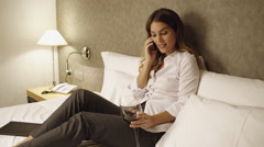 Young business woman in hotel room Stock Footage