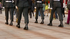 March soldiers legs, boots and uniform, stomp on pavement with brisk sound Arkistovideo