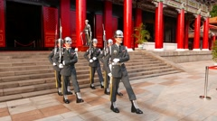 Guards come down stairs and slowly march to gate, Taipei Martyr's Shrine Stock Footage