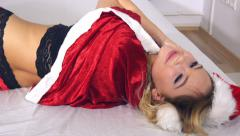 Christmas fun with playful lingerie blond girl on bed Stock Footage