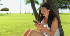 Young caucasian woman texting cell phone on a beach Stock Footage