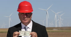 Stock Video Footage of Energetic Industry Alternative Wind Power Energy Manager Show US One Dollar Bill