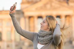 Selfie with hand in hair - stock photo