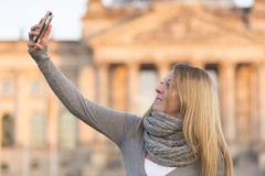 Making a selfie with arm raised - stock photo