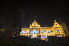 Brasov townhall and Capitoline Wolf Statue in front  decorated for Christmas - stock photo