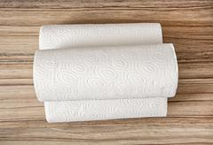 Toilet paper on the wooden background, hygiene theme Stock Photos